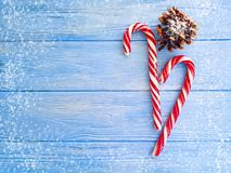 Candy, snow bump xmas on a wooden background, christmas. Candy, snow bump on a wooden background xmas christmas stock photo
