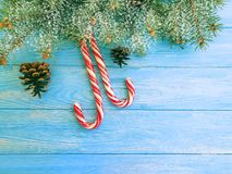 Candy, snow bump xmas festive design on a wooden background, Christmas tree. Candy, snow bump on a wooden background xmas Christmas tree festive design stock photo