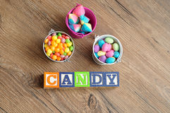Candy spelled in alphabet blocks Royalty Free Stock Photos