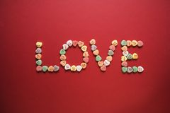Candy spelling out love. Royalty Free Stock Images