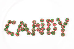 Candy Spelling out the word C A N D Y. Red and Green Sprinkles chocolate candy spelling out the word Candy isolated on a white background Stock Images