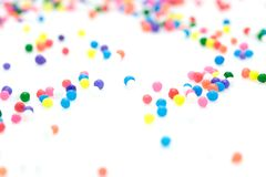 Candy Sprinkles. A photo of some candy sprinkles over a white background Stock Image