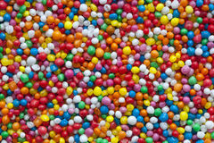 Candy Sprinkles Background. Candy sprinkles, in full-frame background.  Colorful hundreds and thousands or nonpareils Stock Image