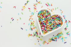 Candy Sprinkles. Heart shaped cookie cutter with candy sprinkles Stock Photo