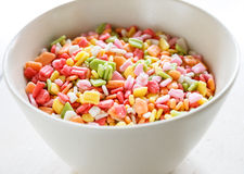 Candy sprinkles. On white cup Royalty Free Stock Image