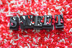 Candy sprinkles with the word sweet Stock Photo