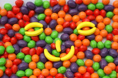 Candy stash. Large amount of colorful candy spread into a face on a plate royalty free stock photography