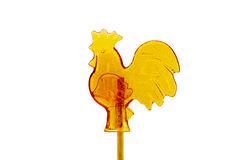 Candy on a stick in the form of a rooster isolated on a white background Stock Photo