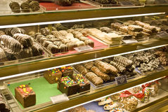 Candy store. Shelf with variety of desserts Stock Photography