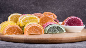 Candy. Sweet marmalade in the form of citrus slices stock images