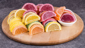 Candy. Sweet marmalade in the form of citrus slices stock photos