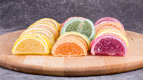 Candy. Sweet marmalade in the form of citrus slices stock photo