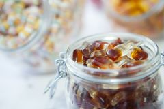 Candy sweets, coca jelly sweets in a jar. Sweets on a table ready for a wedding Stock Images