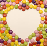 Candy sweets in love heart shape Royalty Free Stock Images