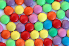 Candy swirl - smarties. Colored background Stock Photo