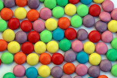 Candy swirl - smarties. Colored background Royalty Free Stock Image