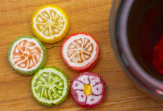 Candy and tea on wooden table,top view. Royalty Free Stock Photography