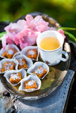 Candy on a tray. Candy with tea on a tray Stock Photography