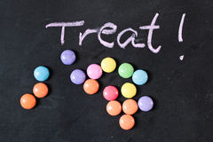 Candy treat. Colorful sweets and treat written on a black surface Royalty Free Stock Images