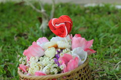 Candy valentines hearts and artificial flowers Royalty Free Stock Images