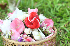 Candy valentines hearts and artificial flowers Stock Image
