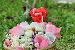 Candy valentines hearts and artificial flowers Royalty Free Stock Image