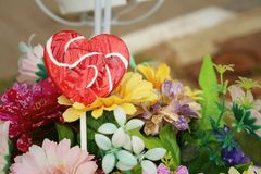 Candy valentines hearts on background of flowers Royalty Free Stock Image