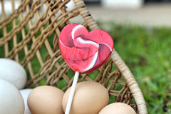 Candy valentines hearts and vintage easter eggs Stock Photos