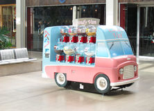 Candy van. A candy van situated in the indoor shopping mall at milton keynes, buckingham, United Kingdom. Various sweets or candy in sealed containers and Stock Photography