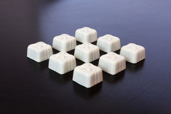 Candy white chocolate on a dark background Stock Photos