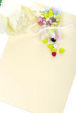 Candy with a white flower laid Royalty Free Stock Photos