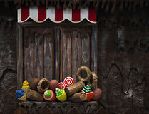 Candy in Window. Various fake cupcakes, candy, doughnuts, and ice cream cones decoration on wooden window ledge Stock Image