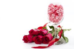 Candy in wine glass with rose Royalty Free Stock Photos