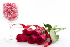 Candy in wine glass with rose Stock Image