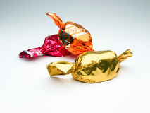 Candy wrapped in colored foil Stock Photos