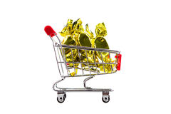 Candy in wrappers in shopping cart, isolated on white background. Stock Photography