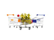 Candy in wrappers in shopping cart on white background. Candy in wrappers in shopping cart on white background Royalty Free Stock Image