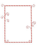 Candycane Border Isolated on White. Whimsical Christmas frame of candy canes isolated on white Royalty Free Stock Image