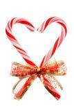 Candycanes при красный (изолированный) смычок Стоковое Изображение