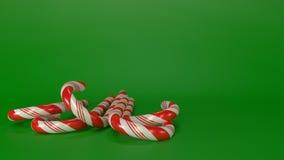 Candycanes avec le fond vert Photo libre de droits