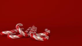 Candycanes med röd bakgrund Arkivfoton