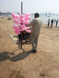 Candyfloss seller. On the beaches of mumbai selling pink candyfloss Royalty Free Stock Image