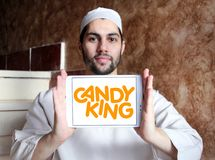 Candyking company logo. Logo of Candyking company on samsung tablet holded by arab muslim man. Candyking is a Swedish company that markets pick and mix stock photography