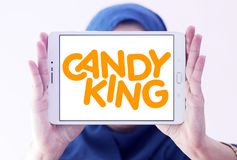 Candyking company logo. Logo of Candyking company on samsung tablet holded by arab muslim woman. Candyking is a Swedish company that markets pick and mix stock photography