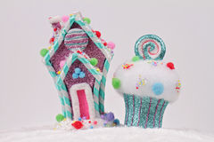Candyland Christmas. Merry Christmas and Happy New Year background. Colorful Candy house and cupcake christmas tree decorations on Royalty Free Stock Photography