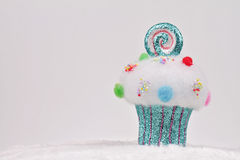 Candyland Christmas. Merry Christmas and Happy New Year background. Colorful cupcake christmas tree decoration on white background Stock Photography