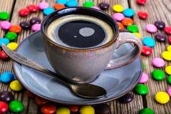 Candys和浓咖啡 图库摄影