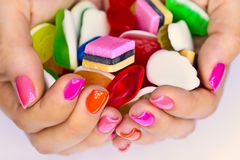 Candys in hands Royalty Free Stock Image