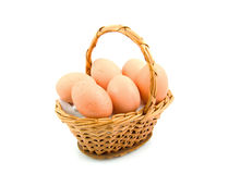 Cane basket with chicken eggs Stock Photo
