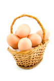 Cane basket with chicken eggs Royalty Free Stock Photos